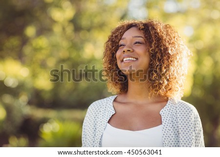 Beautiful woman smiling on a sunny day #450563041