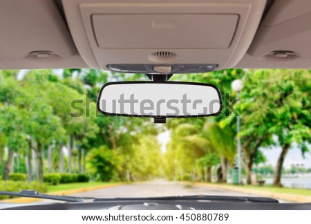 Car rear view mirror inside the car. Royalty-Free Stock Photo #450880789