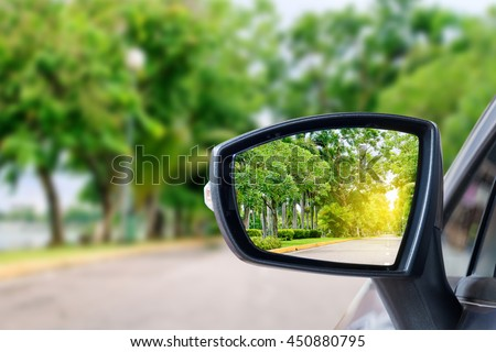 side rear-view mirror on a car. #450880795