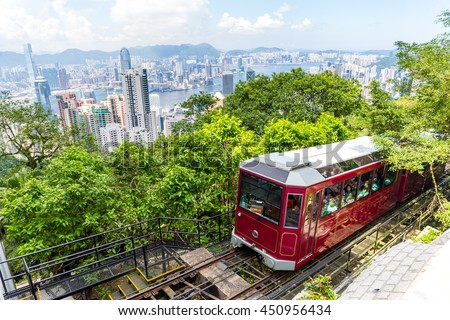 Victoria Peak Tram and Hong Kong city skyline Royalty-Free Stock Photo #450956434