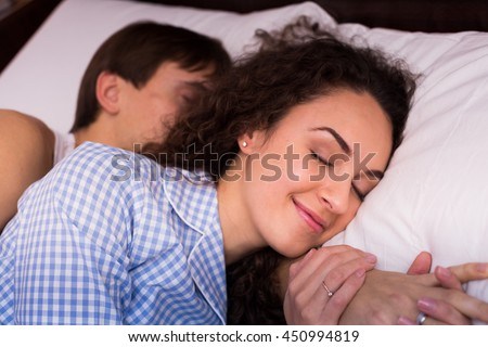 Portrait of young adults hugging each other while sleeping #450994819
