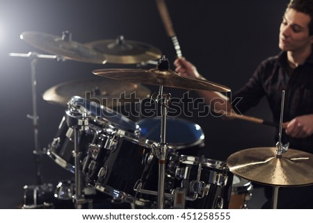 Side View Of Young Drummer Playing Drum Kit In Studio #451258555
