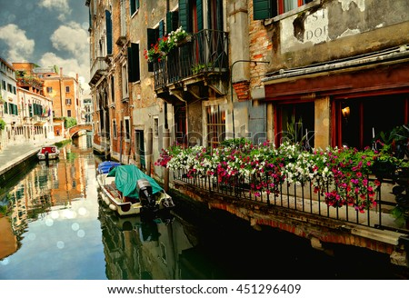 Classical picture of the venetian canals with gondola across the canal #451296409