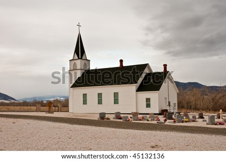 a small country church and cemetery in the  mountains of Montana #45132136