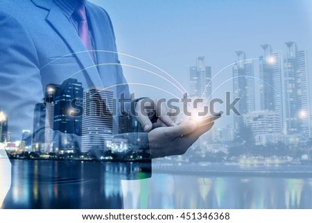 double exposure of businessmen using smart phone with blur city night and network connection concept  #451346368