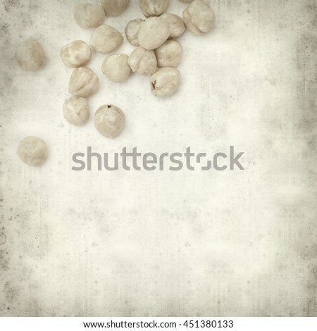 textured old paper background with shelled hazelnut #451380133