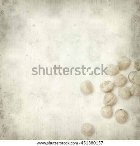 textured old paper background with shelled hazelnut #451380157