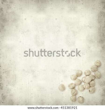 textured old paper background with shelled hazelnut #451381921