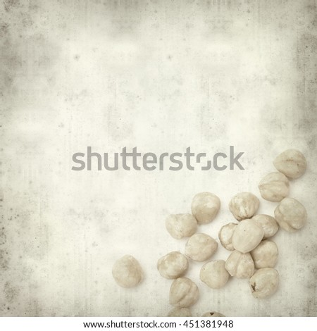 textured old paper background with shelled hazelnut #451381948