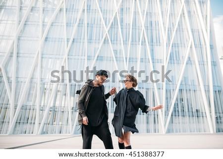 The couple in love  ride a skateboard near big supermarket #451388377