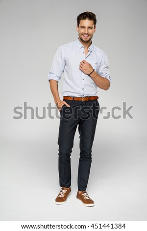 Handsome man wear blue shirt and posing in studio #451441384