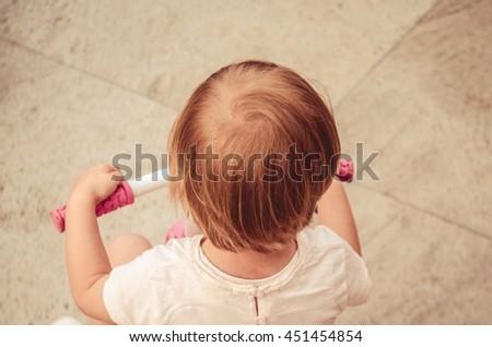 Caucasian children aged 2-3 years on her pink bike #451454854