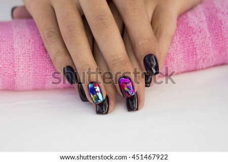 Hands girl with beautiful manicure on a pink towel. #451467922