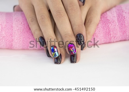 Arm girls with trendy beautiful manicure on a pink towel #451492150