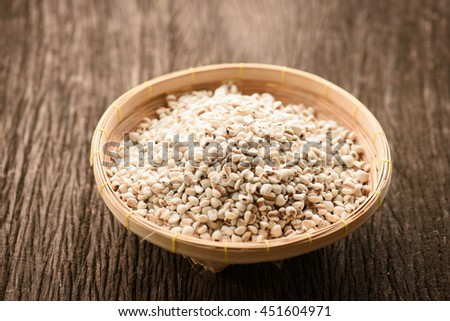 close up of organic millet on wooden rustic table #451604971