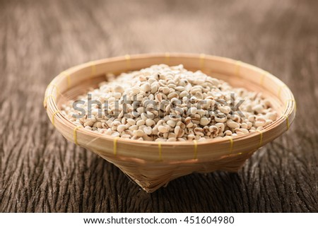 close up of organic millet on wooden rustic table #451604980