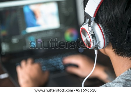 video editing, computer laptops and headphones.