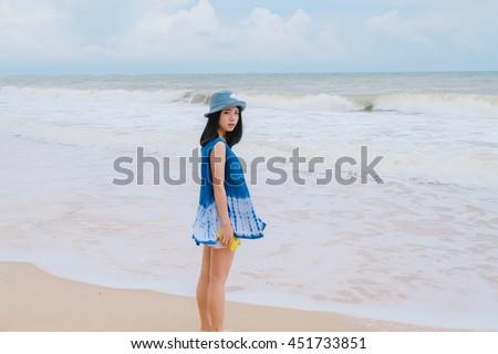 A girl wear indigo dyed cotton cloth on the sea #451733851