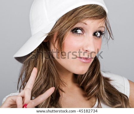 Close Up Shot of a Beautiful Teenager Girl in a White Baseball Cap #45182734
