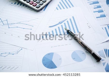 Desk office with pen, analysis report ,calculator. view from top. concept of business analysis, data analysis. #452113285