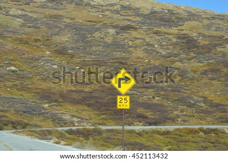 Traffic sign in mountains #452113432
