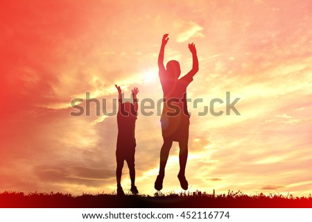 Silhouette children playing on sunset #452116774