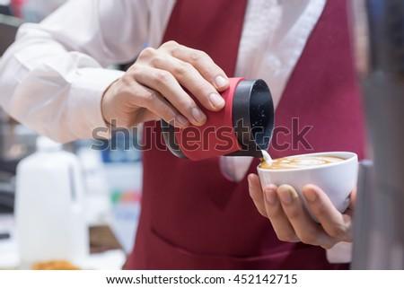 Barista hands to make art coffee #452142715