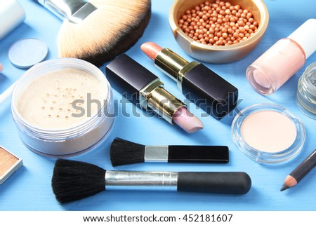 female cosmetics on a blue wooden background #452181607