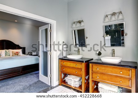 Bathroom interior with two cabinets and two sinks. Opened door to the bedroom #452228668