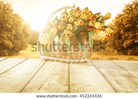 sun and flowers in basket  #452265436
