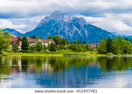 a village near the lake and the mountains on the horizon #452407981