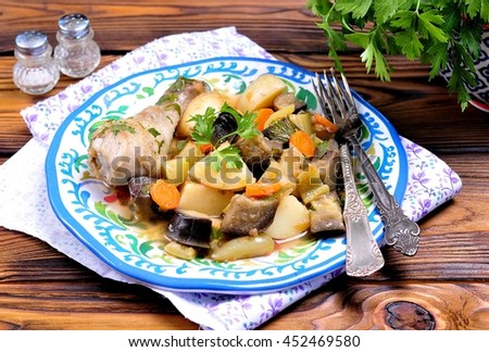 Chicken stew  with vegetables, potatoes, eggplant, zucchini, onions, carrots, tomatoes, garlic and parsley #452469580