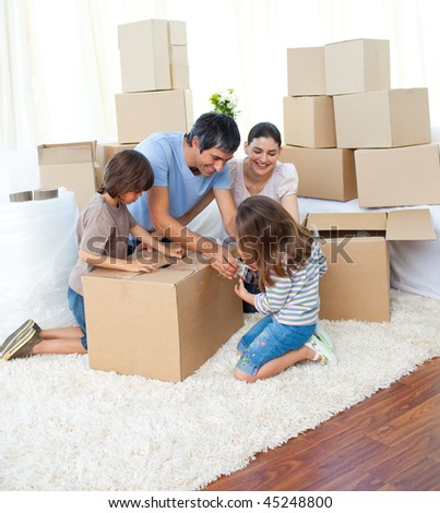 Animated family packing boxes while moving house #45248800