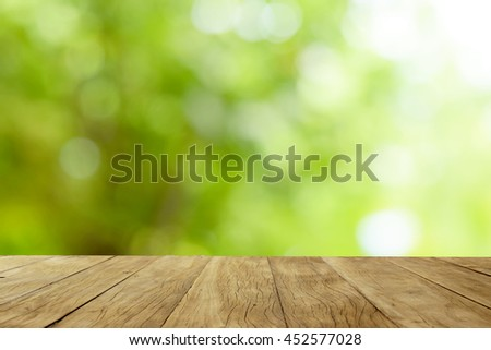 Empty wooden table on green bokeh blur background #452577028