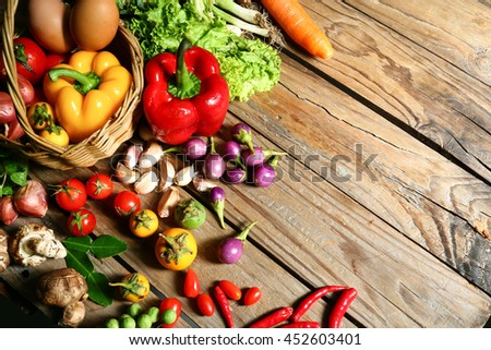 Include fresh organic vegetables basket on wooden floor with copy space still life #452603401