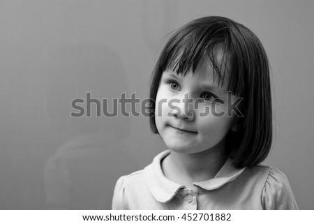 Pensive little girl #452701882