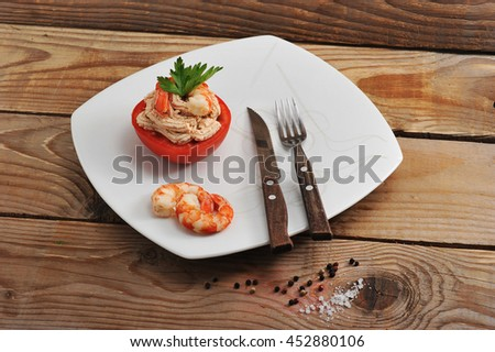 shrimp and tomato dish on wooden background. the view from the top #452880106