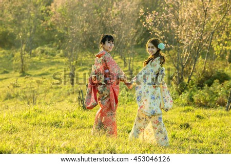 Asian woman with dress traditional Chameleon in the sakura garden,Thailand #453046126