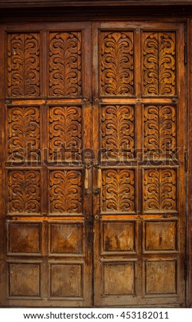 The old wooden doors of the 19th century with elements of plants ornament #453182011