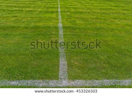 White stripe on the green soccer field, football field grass #453326503