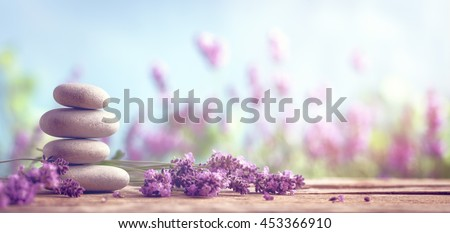 Spa still life with stack of stones and lavenders #453366910