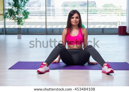 Young woman doing exercises in gym health concept #453484108