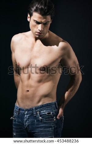 Shirtless muscular man in jeans #453488236