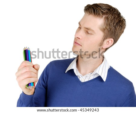 This is an image of caucasian man looking at color pencils. #45349243