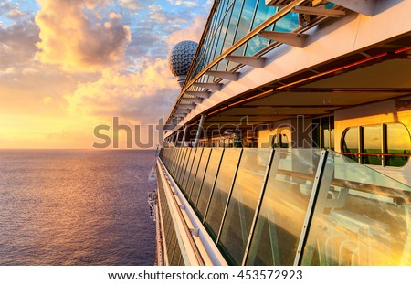 Sunset from the open deck of luxury cruise ship Royalty-Free Stock Photo #453572923