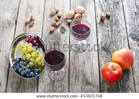 autumn still life with wine, apples, grapes, nuts on old wooden #453601768