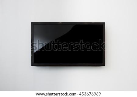 Black LED tv television screen mockup / mock up, blank on white wall background #453676969