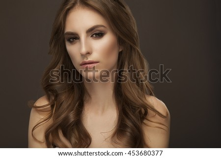 isolated woman on grey background with long hair #453680377