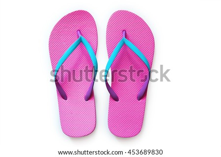 Pink flip flops isolated on white background. Top view #453689830