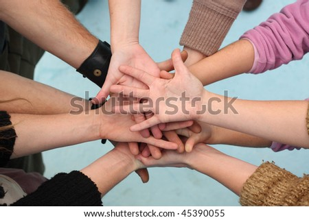 Five people join their hands together #45390055